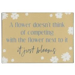 Emaljeskilt med tekst. A flower doesn't think....